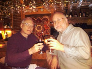 The author, (right), shares a toast with his buddy Errol.
