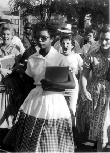 "Little Rock Nine student Elizabeth Eckford passes by passionate ""states' rights"" advocates."