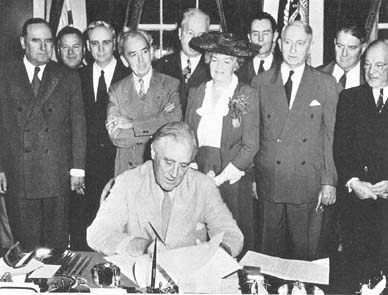FDR signs into the the GI Bill of Rights, June 22, 1944.