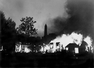 Against the backdrop of the Washington Monument, flames consume the BEF camp and its former occupant's belongings.