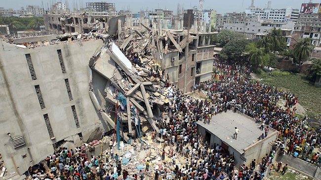 At least 250 workers have been killed in this collapsed eight-story building housing several garment factories. Photo credit: AP/ A.M. Ahad